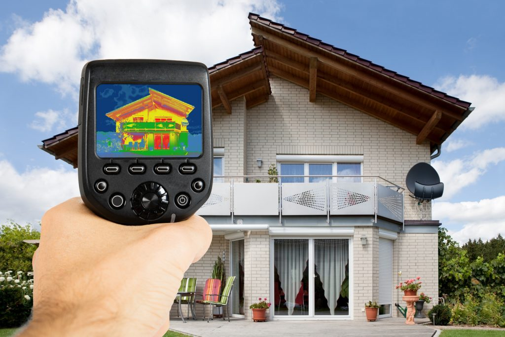 Person Using Infrared Thermal Camera Outside The House - Techcon Home Inspection Services Long Island